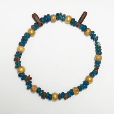 Necklace, granulated and plain gold, glass and amber beaded work, probably made in Tuscany (Etruria), 500-400 BC. Necklace of embossed and granulated sheet gold, with blue glass and amber beads.  Embossed and granulated sheet gold with blue glass and amber beads.