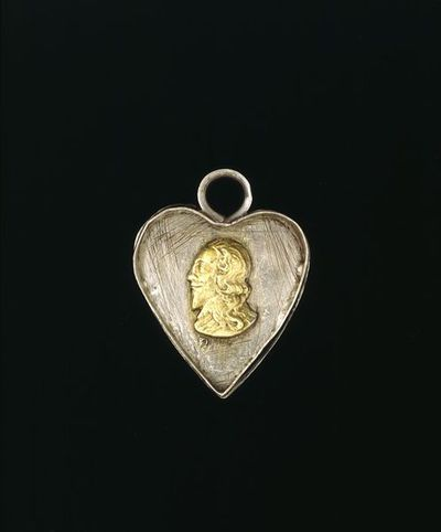 Locket, silver, heart shaped, with busts of Charles I and II, and Henrietta Maria, made in England, 1600-1700.