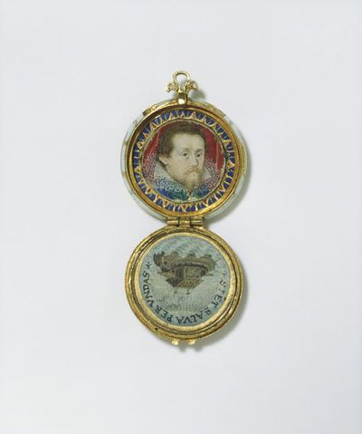 Small circular locket decorated with opaque and translucent enamel.