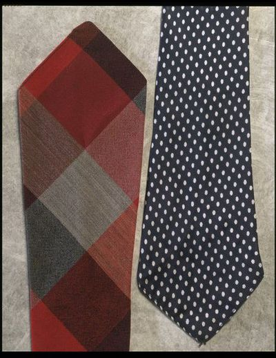Rayon tie, Winfields, Great Britain, ca. 1940. Polka dot rayon tie in navy and white.Rayon.