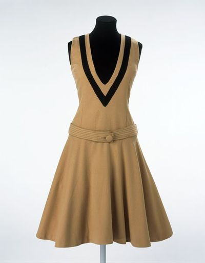 Day dress, brown and black wool, designed by Mary Quant for Bazaar, London, 1961. Brown wool dress with gently fitted bodice, dropped waist with top-stitched belt that buttons in front, and flared knee-length skirt. Contrast black band outlining deep V neckline. Sleeveless.Wool.