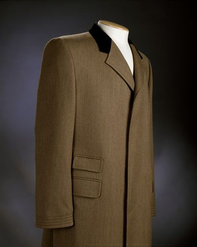 Man's coat, green wool with velvet collar, Cordings, British, 1996.