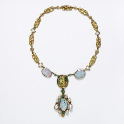 Necklace, gold, set with opals, pearls and emeralds and decorated with enamel, designed by Henry Wilson, made at the workshop of Henry Wilson, London, about 1905. Necklace, gold, set with opals, pearls and emeralds and decorated with enamel. With pendant medallion depicting a kneeling figure of a girl.  Gold, enamelled, opals, pearls, emeralds.