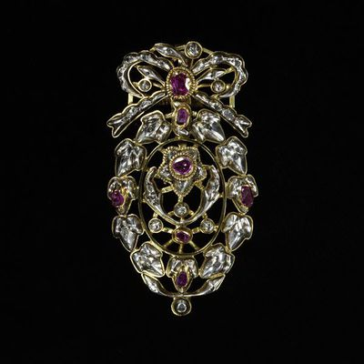 Pendant, diamond sparks and rubies set in gold and silver openwork, probably Portugal, 18th century. Pendant, diamond sparks and rubies set in gold and silver openwork; a bow applied to the front of the suspension loop.  Diamonds and rubies set in gold and silver.