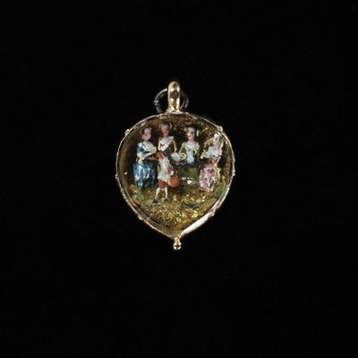 Pendant, gold, set with an enamelled group of a tea-party, England, mid 18th century. Pendant, gold, set with an enamelled group of a tea-party, modelled in relief.  Gold with enamelling.