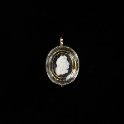 Pendant, gold, set with a cameo under crystal of George I, England, about 1715. Pendant, gold, set with a cameo under crystal of George I (reigned 1714-1727).  Gold with crystal.