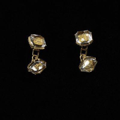 Pair of sleeve links, gold, set with a cipher in gold wire under crystal, England, early 18th century. Pair of sleeve links, gold, set with a cipher in gold wire under crystal.  Gold with crystal.