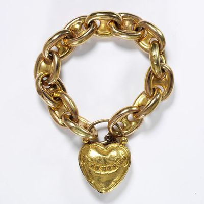 Bracelet with a gold locket stamped with the word 'GRATITUDE', England, the locket about 1835, the chain about 1850.Bracelet of large gold chain links with a gold locket stamped with the word 'GRATITUDE'.Stamped gold with gold chain.