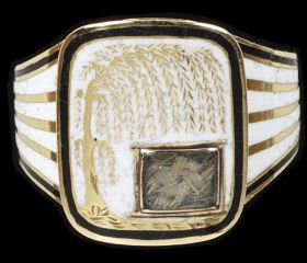 Gold mourning ring enamelled in black and white. The shaped rectangular bezel, with a willow tree reserved on white enamel with a small glazed locket containing hair. Inscribed behind 'Anna/ Seward./ Ob. 25 March, 1809.' Aet. 66.', England, ca.1809.Gold mourning ring enamelled in black and white. The shaped rectangular bezel, with a willow tree reserved on white enamel with a small glazed locket containing hair. Inscribed behind 'Anna/ Seward./ Ob. 25 March, 1809.' Aet. 66.'.Enamelled and engraved gold with hair under glass.