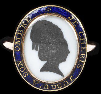 Enamelled gold ring, the oval bezel set with a silhouette of a woman with a locket of hair under the bezel. The border inscribed 'JE CHERIS JUSQU'A SON OMBRE'. A French import mark from 1864 on the hoop, France or England, ca. 1780.Enamelled gold ring, the oval bezel set with a silhouette of a woman with a locket of hair under the bezel. The border inscribed 'JE CHERIS JUSQU'A SON OMBRE'. A French import mark from 1864 on the hoop.Enamelled gold ring set with a watercolour on ivory silhouette and on the back, a panel of woven hair under glass.