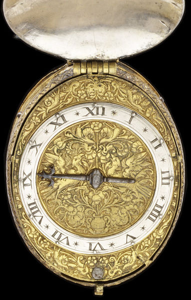 Watch with a silver case and gilt brass dial, both engraved with flower and bird motifs in the style of Michel le Blon, signed 'N Ridgdale', London, about 1610. Watch with a silver case and gilt brass dial, both engraved with flower and bird motifs in the style of Michel le Blon. Signed 'N Ridgdale'.  Engraved silver and gilt brass.