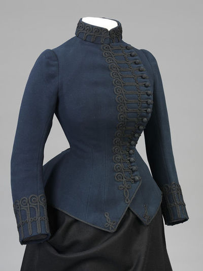 Woman's riding jacket of flannel trimmed with mohair and lined with sateen, designed and made by John Redfern & Sons, England, 1885-1886.Woman's riding jacket of navy blue flannel trimmed with mohair and lined with sateen. Fastened with hooks and eyes beneath the ornamental loop and button fastening. Braid.Flannel trimmed with mohair, and lined with sateen.