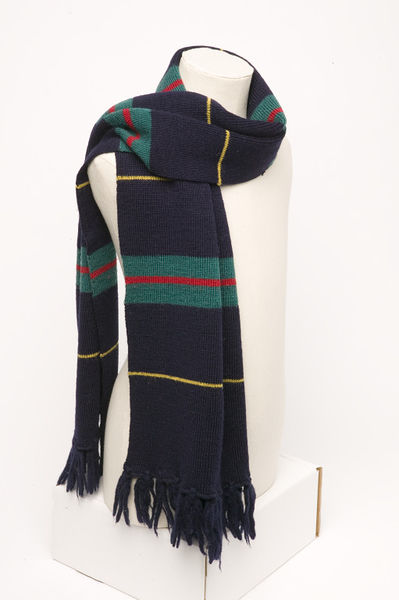 Machine knitted wool, striped in dark green/dark blue/yellow/red; uniform for Queen Mary's High School for Girls, Walsall; made in England by the Stevenage Knitting Co Ltd, ca. 1965.