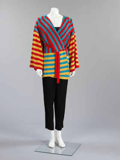 Trouser suit of machine-knitted cashmere stripey jacket, black rayon top and trousers, machine-knitted cashmere belt; British, 1985.