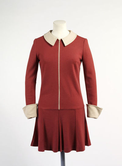 Wool jersey dress by Mary Quant, made in Great Britain, 1964. Rust wool jersey dress, long waisted, with short topstitched flared skirt. Centre front zip, cream Peter Pan collar and turned back cuffs.Wool jersey.
