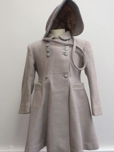Overcoat and bonnet, maker unknown, UK, 1955-1960; Girl's overcoat part of a two piece set. 100% wool of  a woven pattern of cream, baby blue and pink; fully  lined; White Heather, Great Britain, 1955-1960. A-line woollen winter coat for a girl of about 4 years old.  The coat is of a finely woven pattern of powder pink and blue cross hatches with cream crosses at the centres.  The coat has a rounded collar, trimmed with a thin edge of light blue cotton velvet (?).  The front of the coat is double breasted with a high button under the neck and matching concealed button on the other side.  Below this on the front near the upper chest area, are three rows of on each side in a blue plastic with small white flecks.  Slightly lower down, at waist level, there is another singular set of buttons, but the bottom flared portion of the coat is left free.  The coat has two open, front facing upright pockets with a curved edge, also finished with a fine blue velvet trim.  The coat has a fitted and flared shape and is constructed of three back panels and four on the front that then flare out at the waist.  The coat is lined with an oyster coloured satin lining.  The hat is made of a finely woven pattern of powder pink and blue cross hatches with cream crosses at the centres, the same at the matching coat i this set.  The hat is made in a bonnet style of a young child.  There is a reinforced bonnet peak at the front, trimmed with a fine edge of light blue cotton velvet.  There is a looped strap in order to secure the hat to the child.  At the crown of the bonnet the fabric has been gathered into  four decorative folds.
