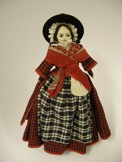 Doll with a wax over composition head, representing a Caucasian female in Welsh national costume; made in Germany, 1840.