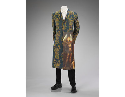 Suit, black rayon wool trousers and woven teal cotton coat, Alexander McQueen, designed in Britain, made in Italy, 1997.
