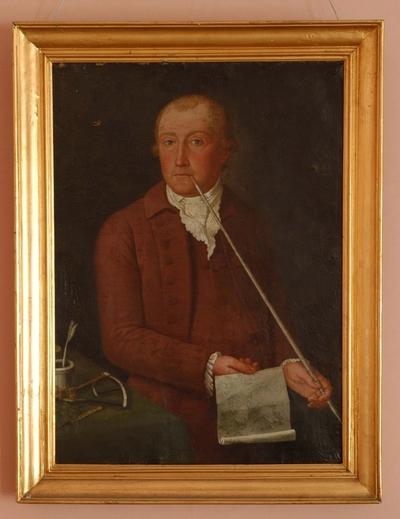 Portrett av mann i halvfigur mot gråsvart bakgrunn