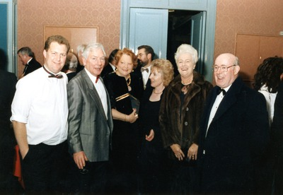 Gay Byrne and Kathleen Watkins standing with guests at the Jacob's Awards