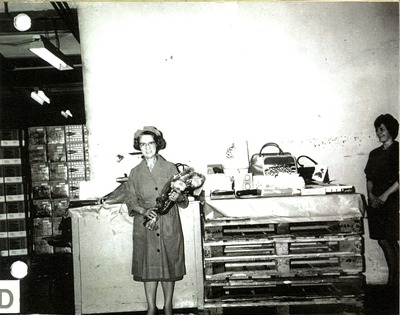 Elderly female Jacob's factory worker receiving gifts