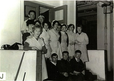 Group photograph of Jacob's Biscuit Factory workers on the steps