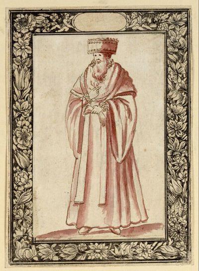 Mann mit Mantel, Kopfbedeckung und Handschuhen