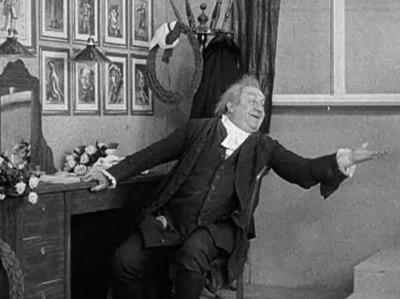 Kgl. Skuespiller Olaf Poulsen i sit Paaklædningsværelse paa det Kgl. Teater