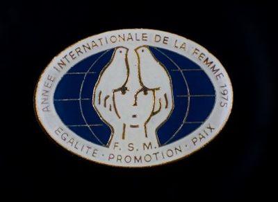 Broche. 'Annee Internationale de la Femme 1975'