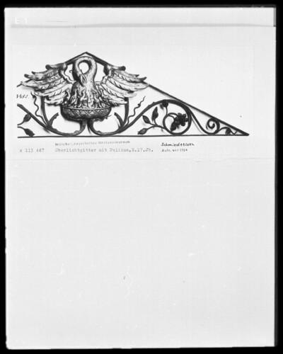 Oberlichtgitter mit Pelikan