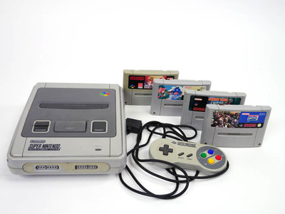 Computerspel Super Nintendo Entertainment System met vier cassettes en besturing