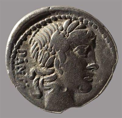 Anverso: Cabeça de Apolo, à direita, atrás: PANSA. À volta rebordo ponteado. Reverso: Minerva numa quadriga, à direita, segurando lança e rédeas com a mão esquerda. No exergo: C.VIBIVS.C.F.