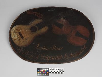 Firmenschild eines Geigenbauers