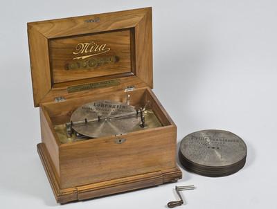 Muziekdoos met metalen schijf van 24 cm. Model: Mira