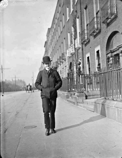 Young man walking and smoking pipe on Merrion Square