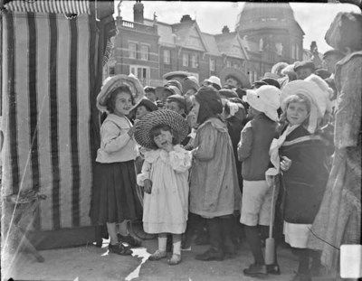 Group of children watching a Punch and Judy show