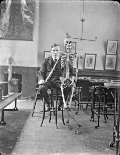 Man seated, possibly J. J. Clarke, with skeleton