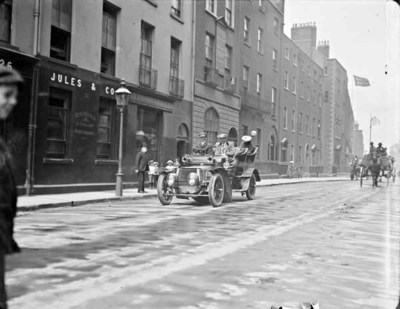 Daimler driving past no. 13 Kildare Street