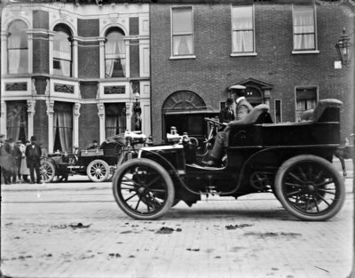 Car driving past the Shelbourne Hotel, St. Stephen's Green. The car is possibly a French Mors with a Tonneau body