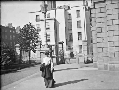Woman walking at the entrance to the National Library, Kildare Street
