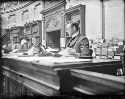 Library assistant with young boy in Reading Room of National Library of Ireland