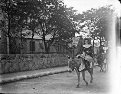 Girl riding a donkey