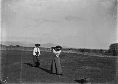 Two ladies playing golf on Golf Links, Ireland