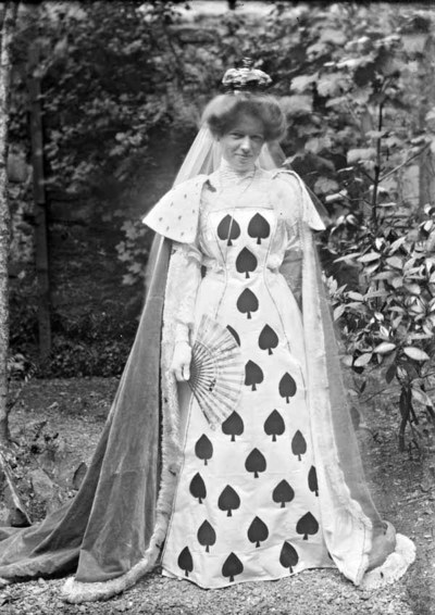 Woman dressed as May, Queen of Hearts, with fan and headdress, Ireland