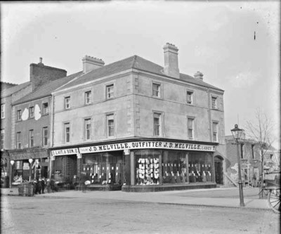 Children outside J. D. Melville's Tailor shop, Ireland