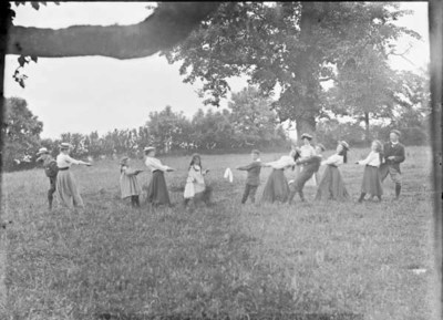 Adults and children playing tug of war, Drumleck, Co. Louth