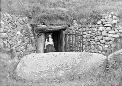 Girl at entrance to Newgrange , Co. Meath