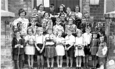 After blackberrying during 1939-45 war. Outside the village school, after the evacuees had returned home to Hull, 2nd World War