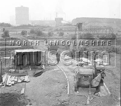 Santon Mining Company record photograph, view taken from the portal arch of the North Adit towards the level crossing spanning the Doncaster to Grimsby mainline, 4 June 1957