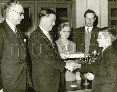 Mayor Gerard McQuade during a presentation, c.1957-1958.